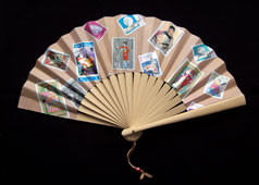 promotional fan with paper stamp decoration